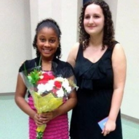 Me and a student after her violin recital