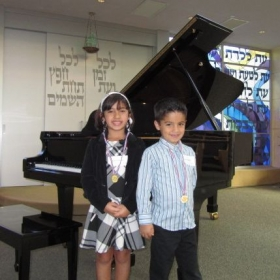 Talar (8 yr old) and Garen S (7 yr old) smiled after their debut performance on 5/10/14. They are motivated to play more pieces.