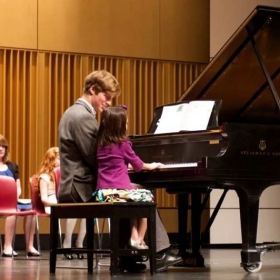 A six-year-old student in recital.