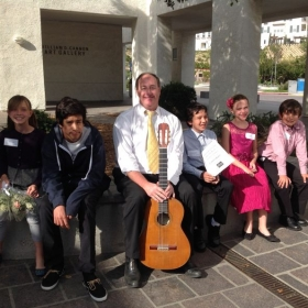 Jesse with his students at the Ruby G. Schulman Auditorium in Carlsbad, after the winter recital.