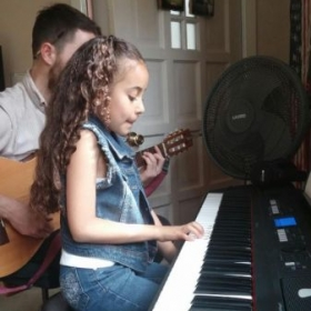 Jackie (age 7) and myself on a duet!