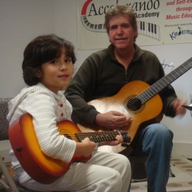 children learn to sing and accompany themselves on guitar