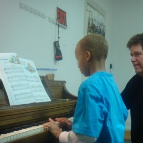 piano students prepare to play in a recital