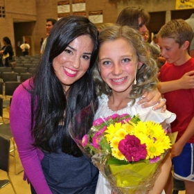 "Madison feeling awesome after singing her lead role as ""Ti Moune"" in ""Once on this Island."" Teacher, Rebekah, congratulates her."