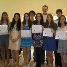 5/24/2014 - Students receive certificates of achievement after completing their bi-annual recital. They have worked very hard!