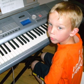 Ryan Aranov learning keyboard.