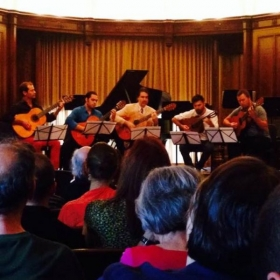 I'm in blue, performing in a tango guitar quintet at Reed College to conclude the Tango Music Institute, 2014.