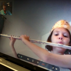 I taught a princess today!  This is a camera shot of a Skype lesson.  You can see me on the screen in the left-hand corner.