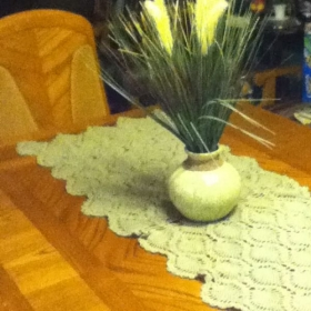 Table runner made with DMC thread crochet.
