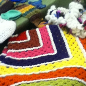 Large Granny Square blanket with an extra feature.