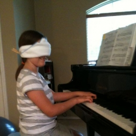 This student is playing her piece blind-folded!  Just a fun thing to do when you know the your song by memory.