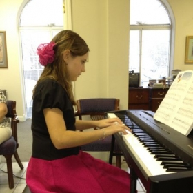 This student is playing Christmas music at a local bank.
