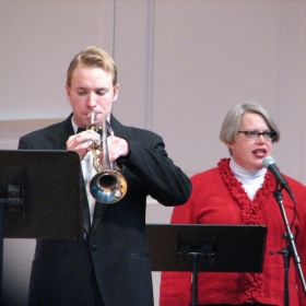 Performing at a Christmas concert with Dr. Mary Hopper in 2006.
