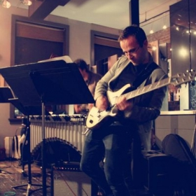 Performing with jazz fusion/classical/video game music ensemble The Disco Cactus.