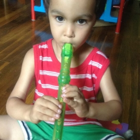 Caleb playing his first recorder.