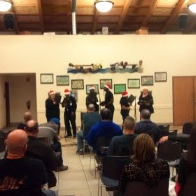 Leading my choir of Veterans at the Veteran's Village in San Diego for their Christmas concert. December 2012.