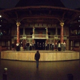 Performing on Shakespeare's Globe stage in London.