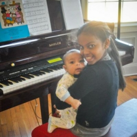 Eldah before lesson wanted to hold baby Rocco and sing to him #soblessed