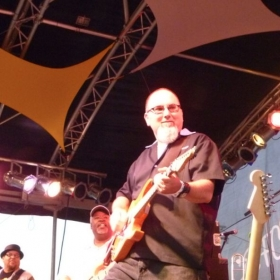 Jamming with the band JAMBONE at a major music festival in Illinois.