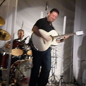 Performance with one of my bands. Playing an acoustic blues number.