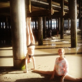 Myself doing a handstand while my student Sarah does the splits. Motivated by Her!