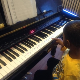 3 year old student learned to play his first octave in the Key of C.