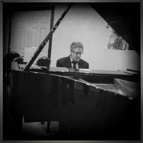 Playing original songs for an event at 