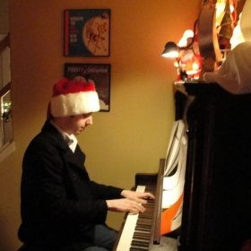 Spreading some holiday cheer on the piano.