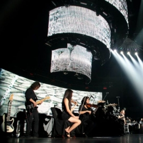 Performing with Mana, a Mexican Rock band, at the Valley View Center (formerly known as Sports arena).