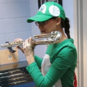 While working at Indy Flute Shop on Halloween I dressed up as Yoshi and I am playing a bass flute!