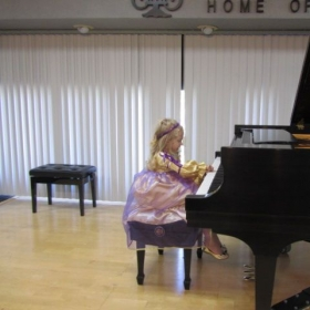 Julia G. (3 year & 10 month old) played at Masquerade Recital of MTACSC Branch on 10-18-14 as her debut performance.