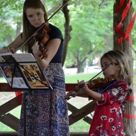 performing with a violin student at Duet Day 2014