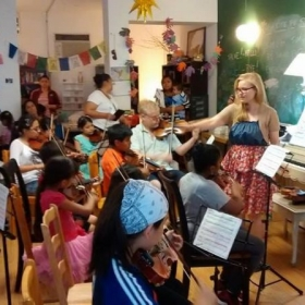 Conducting my student orchestra at Still Waters in a Storm in Bushwick Brookly, 