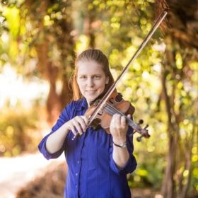 Playing the violin in the Botanical Gardens of San Francisco.