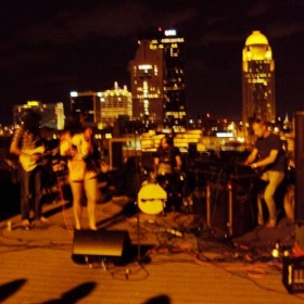 "Performing on the rooftop of Glassworks for the ""Louisville is for Lovers"" compilation."
