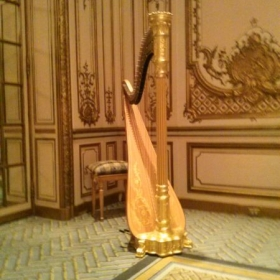 Vintage 1917 Wurlitzer gold harp that Victoria Hughes teaches on.