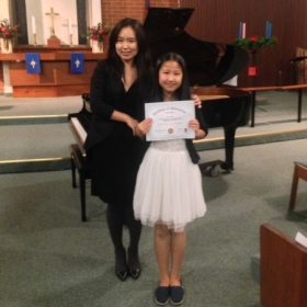 with student after she represented a wonderful performance