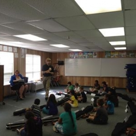 Teaching violin class