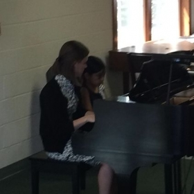 Helping a student during our Spring 2014 Recital! It was great!