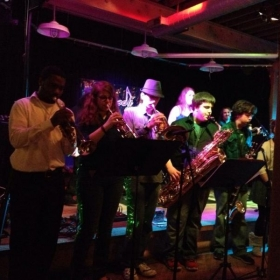 Playing trumpet with a local cover band and some high school students.