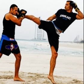 Training a kickboxing student in Dubai. Teaching him how to block head kicks.