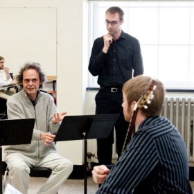 Thomas Foster (standing), in a masterclass with composer Roland Dyens.