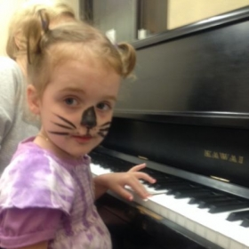 Monet (3 and a half years old!) on her second piano lesson.