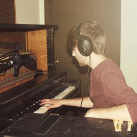 Me recording piano for my groups debut album at The Grid Studio.