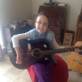 This is Ariel...SUPER GIRL! She is 4 month student and is sight-reading music and playing music.8 years old.