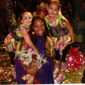 2 of my dance sisters at the finale of my dancers annual recital.