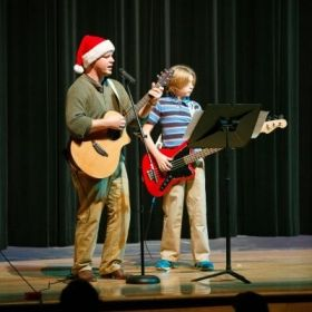 Playing guitar with a student at the 2014 Winter Show!