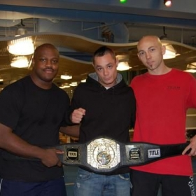Me, Chad and Ian. 1st title belt for our team.