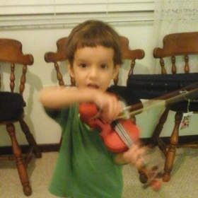 A 3 year old violinist playing Pepperoni Pizza.
