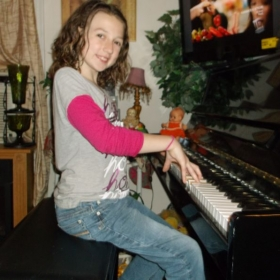 A picture of our one and only granddaughter, Zoey, an upcoming musician as well; Lol!!